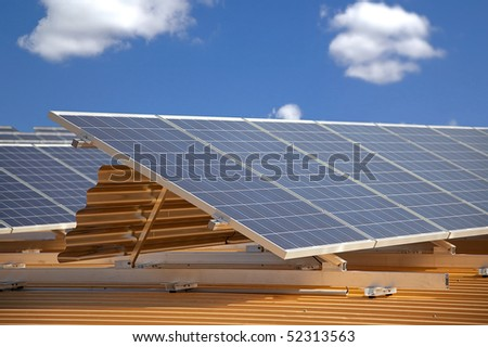 solar panels on roof with shallow depth of field - stock photo
