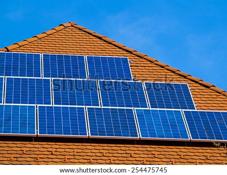 Solar panels on the roof of a building - stock photo