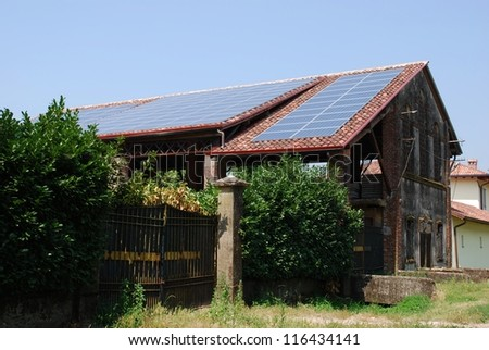 Solar panels on the roof of a farm for ecologic energy