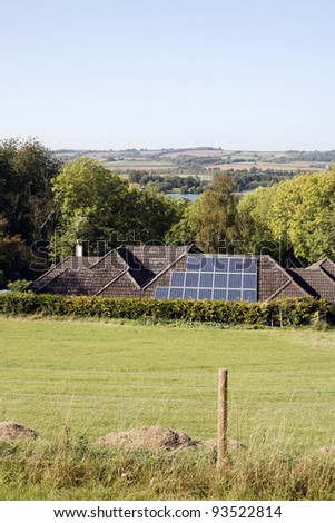 Solar panels on the roof of a house - stock photo