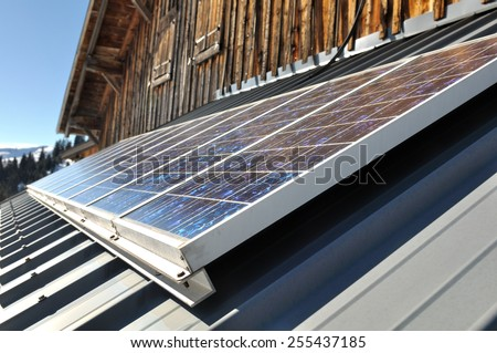Solar panels on the roof of a zinc mountain refuge - stock photo