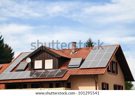 Solar panels on the roof of an apartment house - stock photo
