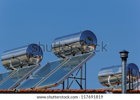 Solar panels on the roof (solar) with water tank - stock photo