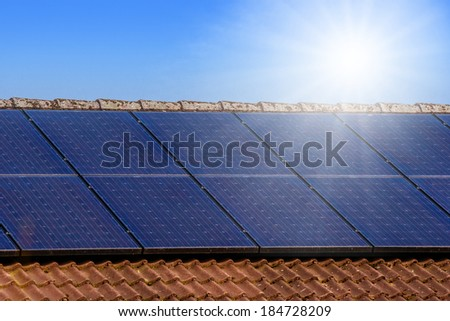 Solar panels on the roof with sunshine