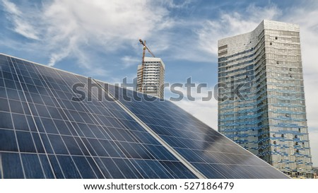 Solar Panels On Top Of A Modern Building