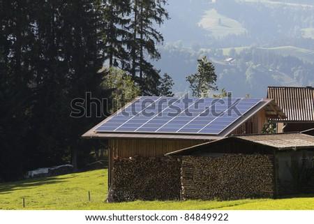 Solar panels on wood house - stock photo