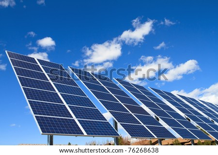 solar panels over blue sky - stock photo
