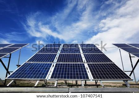 Solar panels over blue sky,Renewable energy. - stock photo