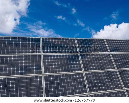 Solar panels over sky background