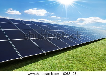 solar panels perspective in a sunny day - stock photo