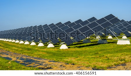 Solar panels placed on a countryside meadow of apulia - stock photo