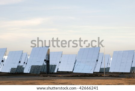 solar panels producing energy with the sun reflections - stock photo
