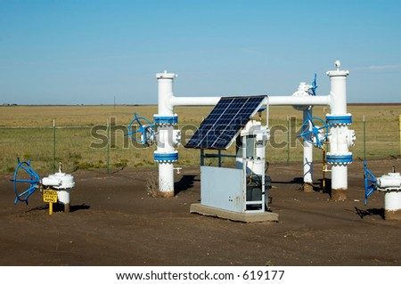 Solar panels provide the electric power for the monitoring equipment on a pipeline in the texas panhandle. - stock photo