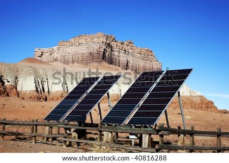 Solar panels providing power in the desert - stock photo