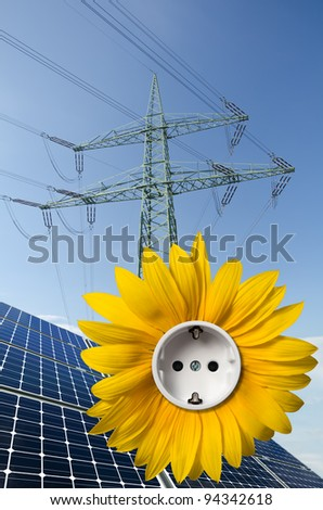 Solar panels, sunflower with socket and utility pole - stock photo