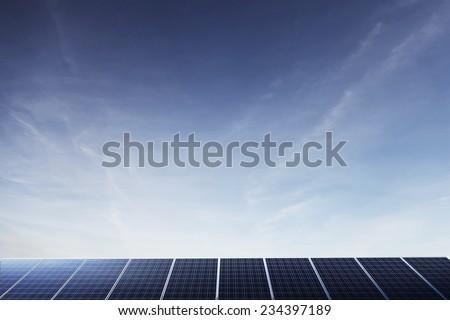 Solar panels under a big blue sky with copyspace. - stock photo