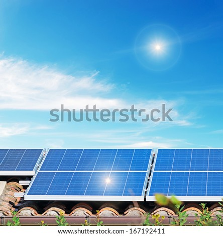 solar panels under a bright sun - stock photo