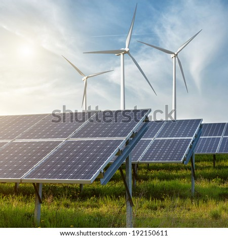 solar panels under blue sky - stock photo