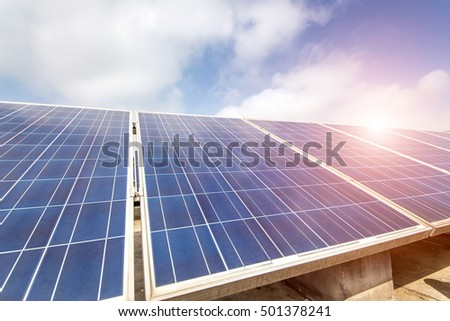 solar panels under blue sky and sunlight