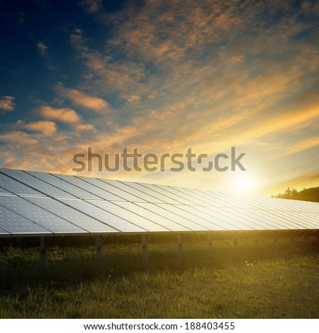 solar panels under blue sky on sunset - stock photo