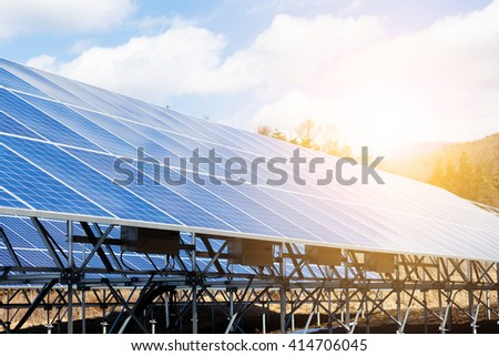 Solar panels under blue sky on sunset - stock photo