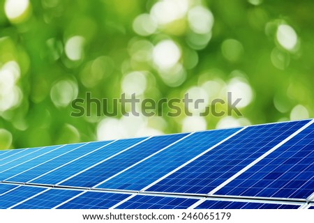 Solar panels under the trees background - stock photo