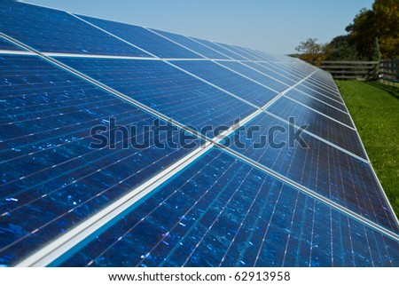 Solar panels used for energy on a farm - stock photo