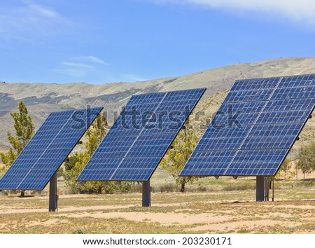 Solar Panels used in a desert rural area. - stock photo