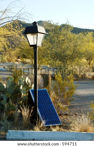 Solar panels used in the desert to provide electricity for lighting in a parking lot. - stock photo