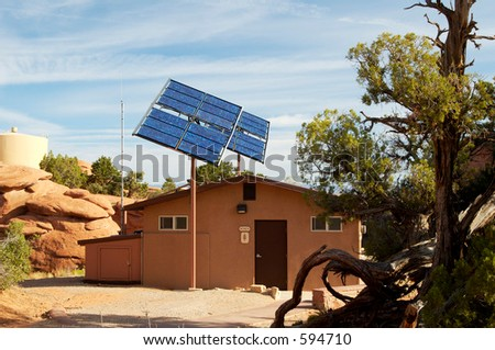 Solar panels used in the desert to provide power for a toilet facility in Arches National Park. - stock photo