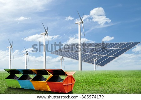 Solar panels,wind turbines, Industrial Waste Bin(dumpster) on green grass with blue sky background,natural Energy And recycling concept - stock photo