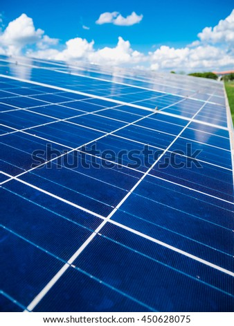 Solar panels with blue sky and clouds, solar energy environmentally friendly green energy
