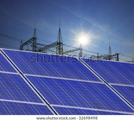 solar panels with electricity pylon - stock photo