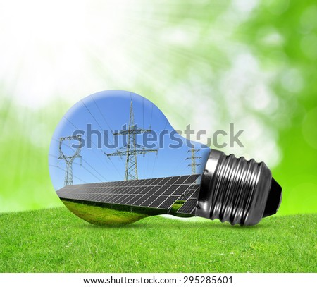 Solar panels with pylons in light bulb. Green energy concept. - stock photo