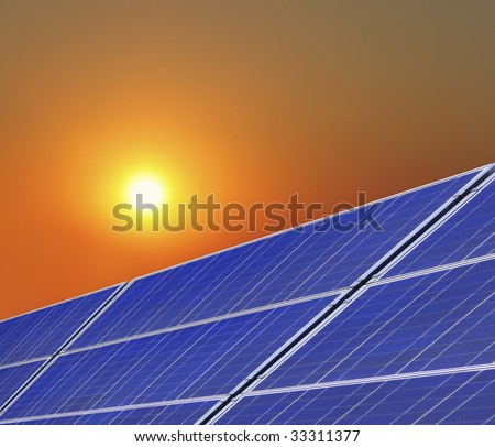 solar panels with sun - stock photo