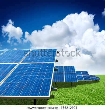 solar panels with the sunny sky - stock photo