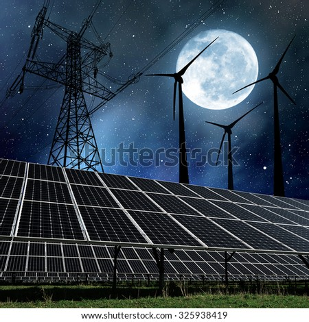 """Solar panels with wind turbines and electricity pylon in night. Clean energy concept.  """"Elements of this image furnished by NASA"""". - stock photo"""