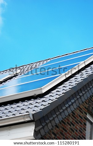 Solar photovoltaic panel on the rooftop - stock photo