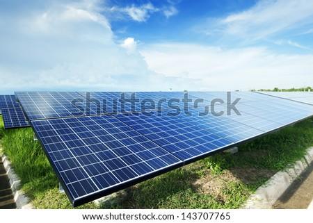 Solar plant under sky - stock photo