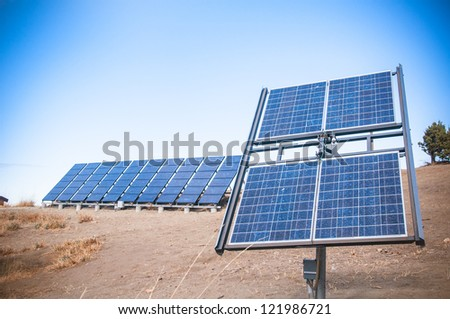 Solar power cell panels in the desert symbolizing the future of energy - stock photo