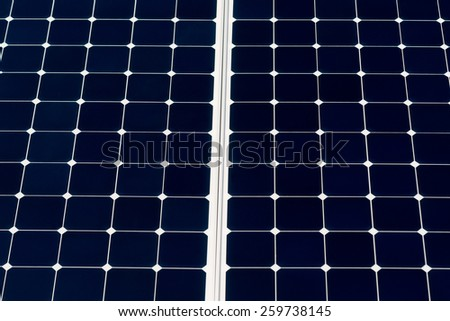 Solar power panel. Closeup view of a solar power panel to generate ecologically clean and renewable energy to feed street lamps and other devices. Deep blue background and a white grid. - stock photo