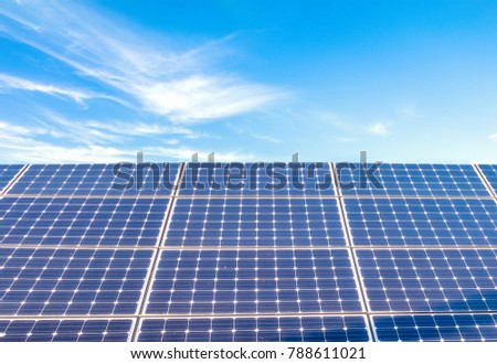 Solar power panels for innovation green energy for life with blue sky background.