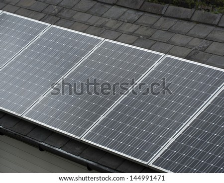 Solar power panels on a roof - stock photo