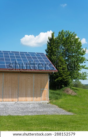 Solar power panels on roof of barn in summer