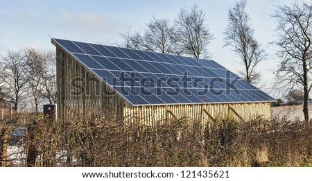 Solar power panels producing energy for power and house heating - stock photo