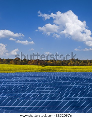 Solar power plant and rapesed field in Autumn; Saxony, Germany - stock photo