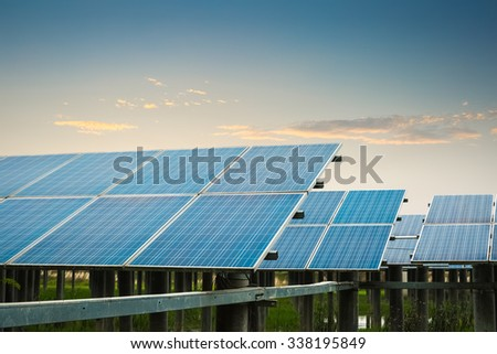 solar power plant at dusk, clean energy concept - stock photo