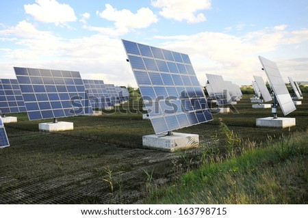 Solar power plant on field - stock photo