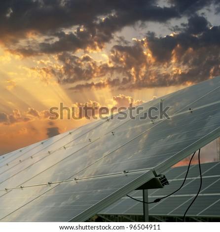 Solar power plant - Sunset over solar power station. Renewable, alternative solar energy. - stock photo