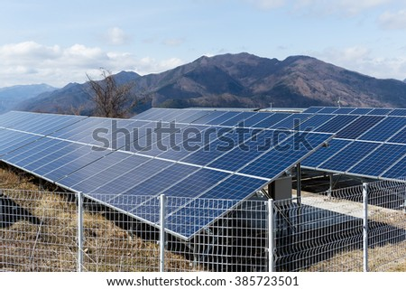 Solar power plant with mountain background